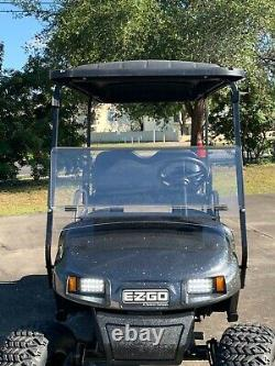 2017 Lifted 48V EZGO 4 Passenger Golf Cart with New Batteries, Paint, Lights, Seat