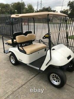 Excellent White 2012 Ezgo 4 passenger seat golf cart Brand New Batteries 48v