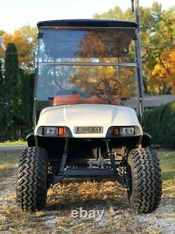 LIFTED EZ-GO TXT Four Passenger Golf Cart New tires, rims, shocks, batteries